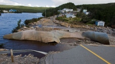 The road through Trouty, Newfoundland and Labrador seen on Friday, Sept. 24, 2010 was washed away by a raging river flooded by hurricane Igor. (Andrew Vaughan / THE CANADIAN PRESS)