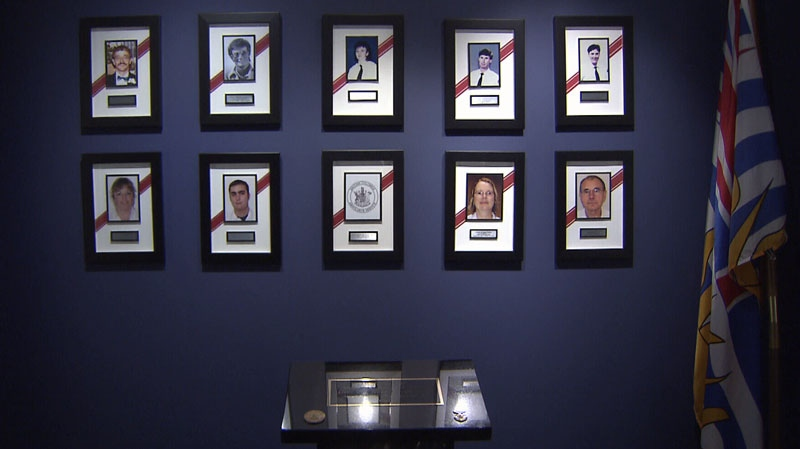 A memorial to fallen paramedics is seen in a BC Ambulance Service office in Vancouver. Sept. 26, 2012. (CTV)