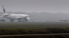A Pakistan International Airlines Boeing 777 plane stands on the tarmac at Stockholm Arlanda International airport Saturday Sept. 25, 2010. (AP / Fredrik Persson)