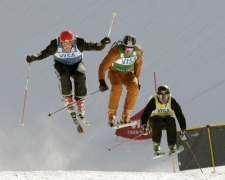 Canada's Davey Barr leads Switzerland's Michael Schmid, left, and United States' Casey Puckett in the men's World Cup freestyle ski cross competition in Park City, Utah on Saturday, Feb. 2, 2008. (AP / Douglas C. Pizac)