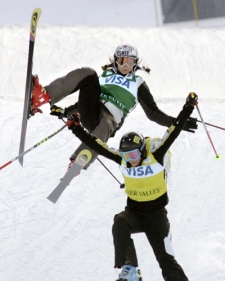 France's Meryl Boulangeat loses control before crashing behind Slovenia's Sasa Faric in the women's World Cup freestyle ski cross competition in Park City, Utah on Saturday, Feb. 2, 2008. (AP / Douglas C. Pizac)