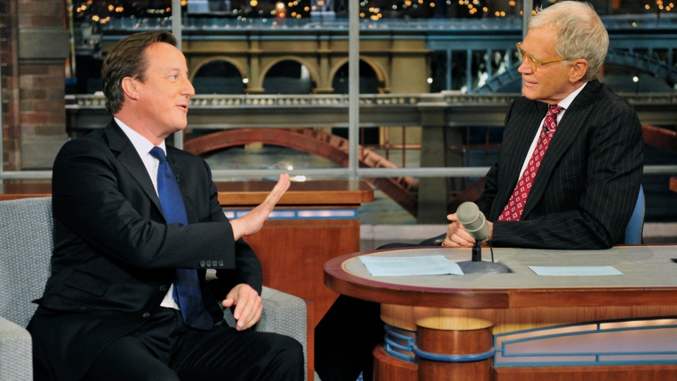 British Prime Minister David Cameron, left, talks with host David Letterman on the set of the 'Late Show with David Letterman,' Wednesday, Sept. 26, 2012 in New York. (AP / John Paul Filo)