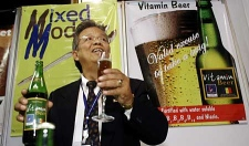 Philippine inventor Billy L. Malang shows off his vitamin beer Saturday, Feb. 2, 2008, at the first International Inventor's Day in Bangkok, Thailand. (AP Photo/David Longstreath