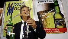 Philippine inventor Billy L. Malang shows off his vitamin beer Saturday, Feb. 2, 2008, at the first International Inventor's Day in Bangkok, Thailand. (AP Photo/David Longstreath
