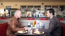 Bruce Willis and Joseph Gordon-Levitt in a scene from Alliance Films' 'Looper.'