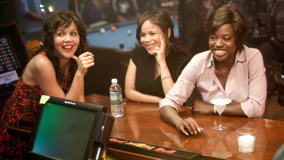 Maggie Gyllenhaal, left, Rosie Perez and Viola Davis, right, in a scene from 20th Century Fox's 'Won't Back Down.'