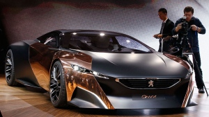 The Peugeot Onyx Concept car is shown at the Paris Auto Show, France, Thursday, Sept. 27, 2012.  (AP Photo/Remy de la Mauviniere)