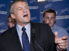 New Brunswick PC leader David Alward,speaks to supporters while his chiildren Jonathan and Benjamin, right, look on Monday, September 27, 2010 at the campaign headquarters in Woodstock N.B. New Brunswickers elected a Tory majority government. (Jacques Boissinot / THE CANADIAN PRESS)