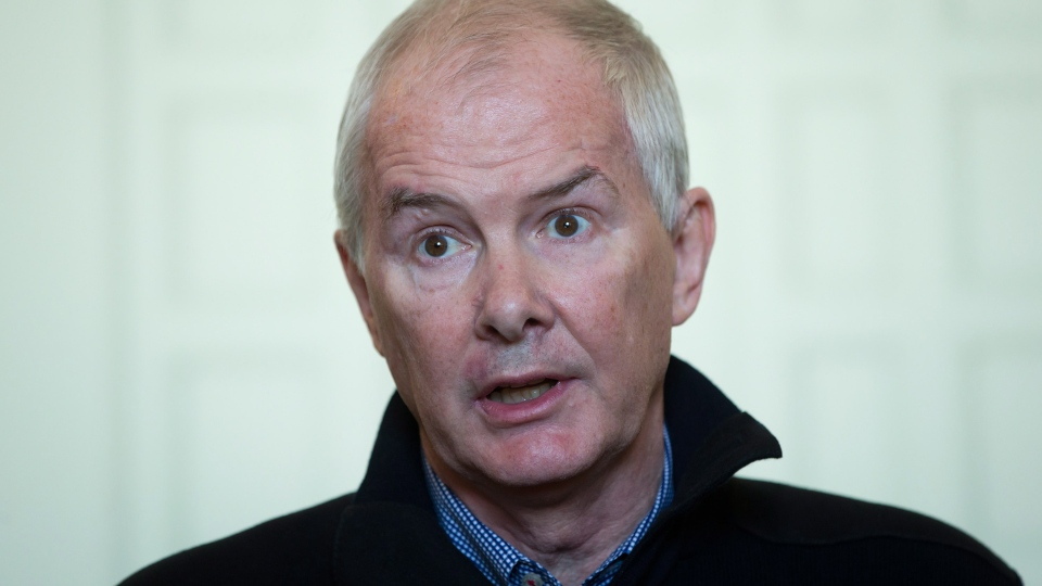 Former VANOC president and CEO John Furlong, reads a statement in response to allegations of abuse brought forward by former First Nations students in Burns Lake dating back to 1969, during a news conference in Vancouver, on Thursday, Sept. 27, 2012. (Darryl Dyck / THE CANADIAN PRESS)