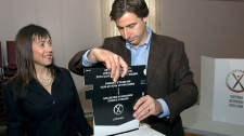Premier Shawn Graham and his wife Roxanne Reeves cast their ballots in the New Brunswick election in Rexton, N.B. on Monday, Sept. 27, 2010. (Andrew Vaughan / THE CANADIAN PRESS)