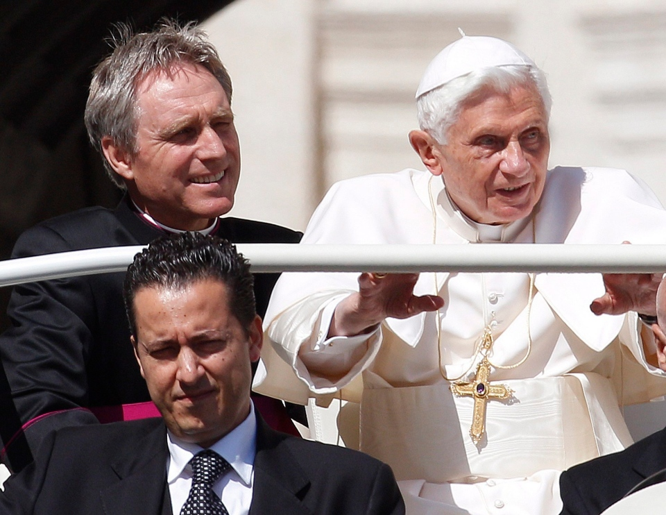 Pope Benedict XVI arrives in St. Peter's square at the Vatican for a general audience as his then-butler Paolo Gabriele, bottom, and his personal secretary Georg Gaenswein sit in the car with him on Wednesday, May 2, 2012. (AP / Alessandra Tarantino)