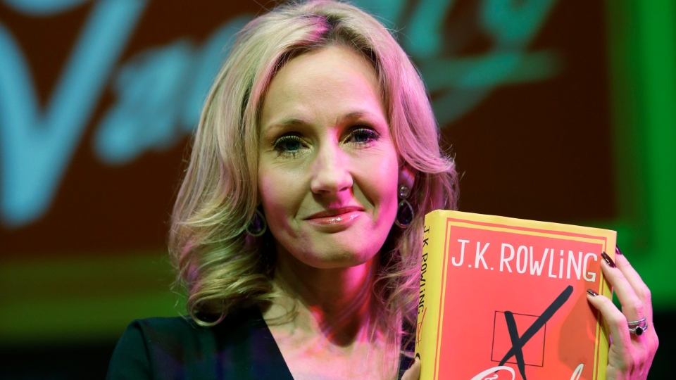 Writer J.K. Rowling poses for the photographers with her new book, entitled: 'The Casual Vacancy', at the Southbank Centre in London on Thursday, Sept. 27, 2012.(AP /Lefteris Pitarakis)