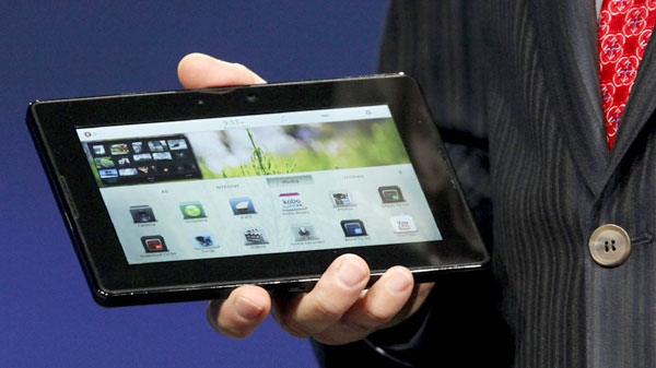 Mike Lazaridis, president and co-CEO of Research in Motion Ltd. (RIM), holds the new PlayBook during the annual BlackBerry developers conference, Monday, Sept. 27, 2010, in San Francisco. (AP / Jeff Chiu)
