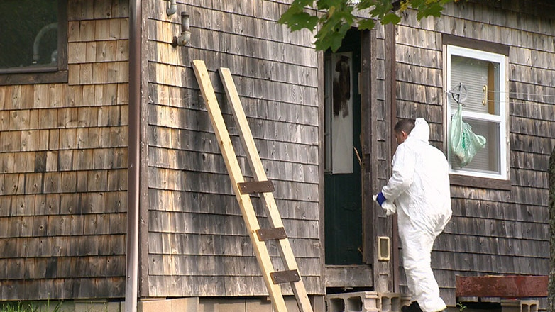 Police investigate the home in Upper Chelsea, N.S., where a boy was allegedly held captive and sexually assaulted by David James Leblanc and Wayne Alan Cunningham.