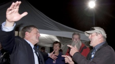 New Brunswick PC leader David Alward, left, opens his arms to a friend and supporter as he leaves Monday, September 27, 2010 (Jacques Boissinot / THE CANADIAN PRESS)
