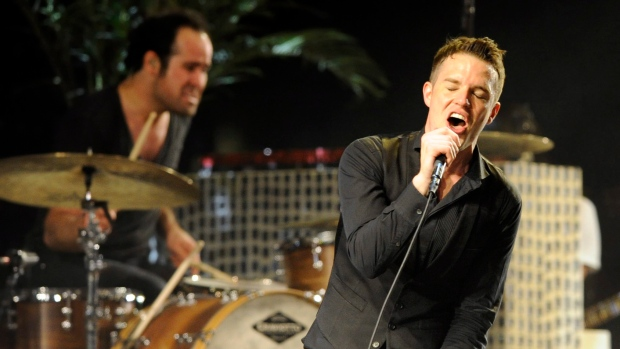 In this April 18, 2009 file photo, Brandon Flowers of The Killers performs during the band's headlin