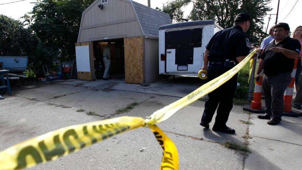 Police tape blocks a driveway where authorities drilled for soil samples in the floor of a shed at a Roseville, Mich. home, Friday, Sept. 28, 2012. (AP / Paul Sancya)