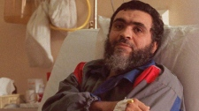 Ahmed Khadr lies in his hospital bed in Islamabad Pakistan on Jan.15, 1996.