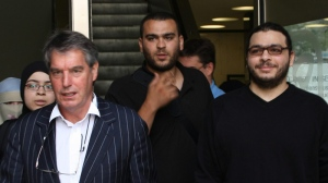 Abdullah Khadr (right), lawyer Dennis Edney (left) and family leave court in Toronto on Aug. 4, 2010