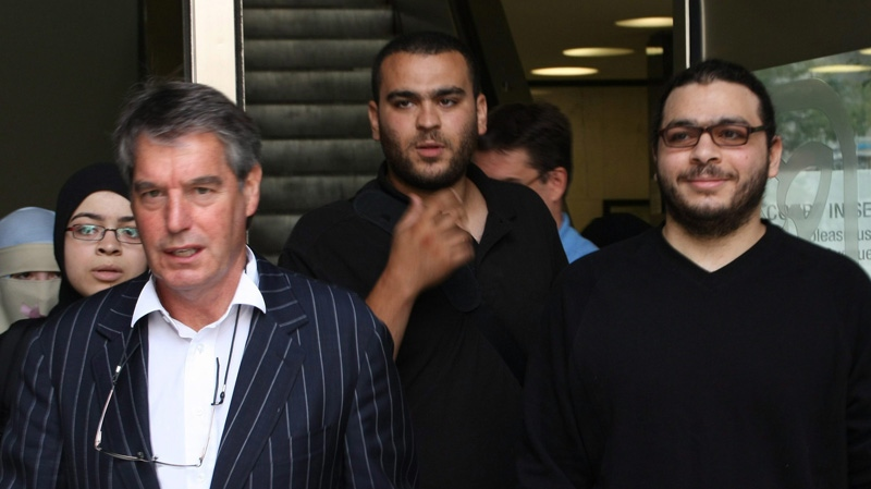 Abdullah Khadr (right), his lawyer Dennis Edney (left) and family members leave court in Toronto, Wednesday, Aug.4, 2010. (THE CANADIAN PRESS/Colin Perkel)