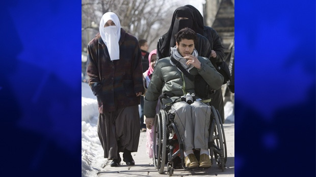 Karim Khadr, brother of Omar Khadr, along with his sisters (in black) and mother Maha Elsamnah (white scarf) leave the Supreme Court of Canada hearing Omar's case, in Ottawa, Wednesday March 26, 2008. (THE CANADIAN PRESS/Tom Hanson)