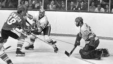 Team Canada's Paul Henderson (left) shoots on Team USSR's Vladislav Tretiak