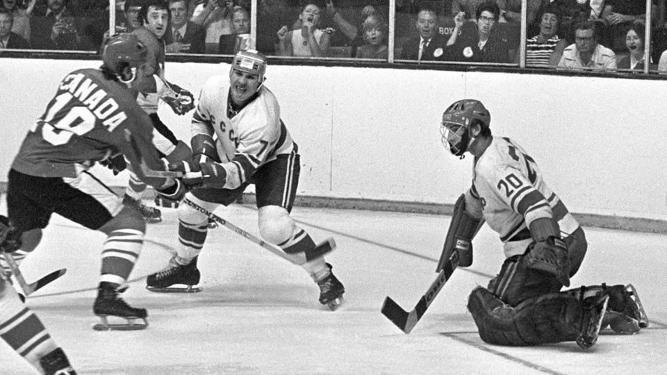 Team Canada's Paul Henderson (left) shoots on Team USSR's Vladislav Tretiak while Gannady Tsygankov defends during the 1972 Summit tournament in Toronto on Sept. 4, 1972. (Peter Bregg /  THE CANADIAN PRESS)