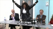 Terri-Jean Bedford, middle, and law professor Alan Young, third from left, react to a decision by an Ontario court that has struck down key provisions of Canada's anti-prostitution laws, in Toronto Tuesday, Sept. 28, 2010.
