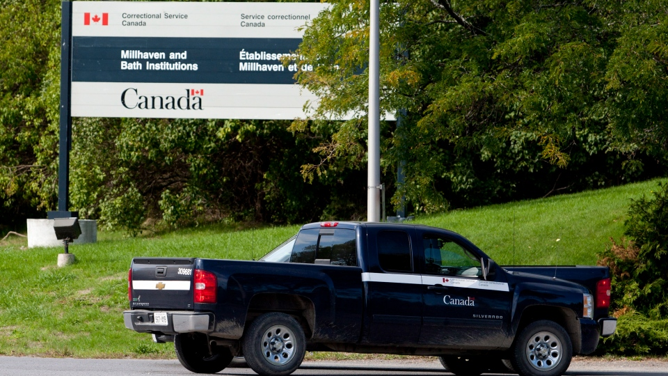 Two Correctional Service of Canada vehicles stand outside the Millhaven Institution maximum-security prison in Bath, Ont., on Saturday, Sept. 29, 2012. (Lars Hagberg / THE CANADIAN PRESS)