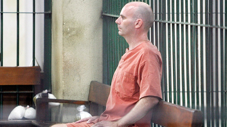 Canadian Christopher Paul Neil sits in the cell at criminal court in Bangkok, Thailand Friday, Aug. 15, 2008. (AP / Sakchai Lalit)