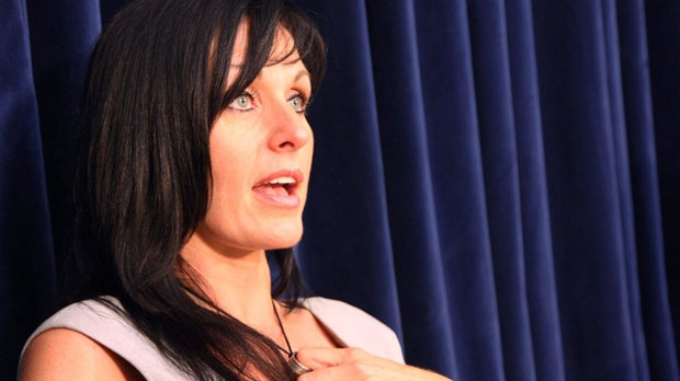 Tabitha Speer, widow of Sgt. 1st Class Chris Speer, who was killed by a hand grenade that Omar Khadr admitted throwing, speaks to reporters on the sentencing of Khadr at his military commission at Guantanamo Bay, Cuba on Sunday Oct. 31, 2010. (CP Photo /Colin Perkel)