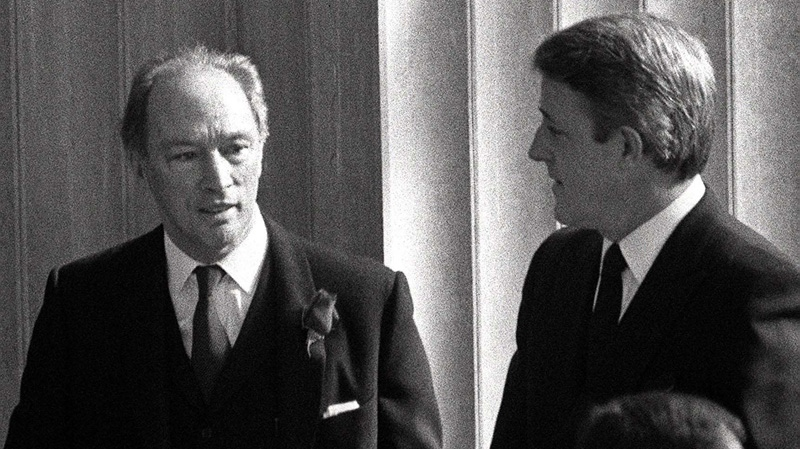 Prime Minister Pierre Trudeau and opposition leader Brian Mulroney are shown here in a rare photo while standing in the shadows Wednesday Mar. 28, 1984, waiting for the funeral service for Chief Justice Bora Laskin to start in Ottawa. (CP PHOTO/ Peter Bregg)