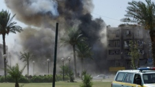 The scene of a car bomb attack in Baghdad, Iraq on Sept. 30, 2012.