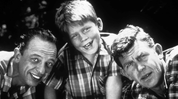 This undated file image shows, from left, Don Knotts, Ron Howard and Andy Griffith.