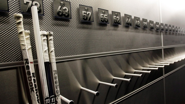 A nearly empty hockey stick rack in the Buffalo Sabres locker room on Sept. 25, 2012.