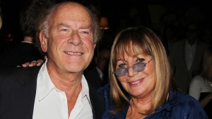 "This image released by Starpix shows singer Art Garfunkel, left, and actress-director Penny Marshall at a book party for Marshall's memoir, ""My Mother Was Nuts,"" Wednesday, Sept. 19, 2012, at Monkey Bar in New York. (AP Photo/Starpix, Dave Allocca)"