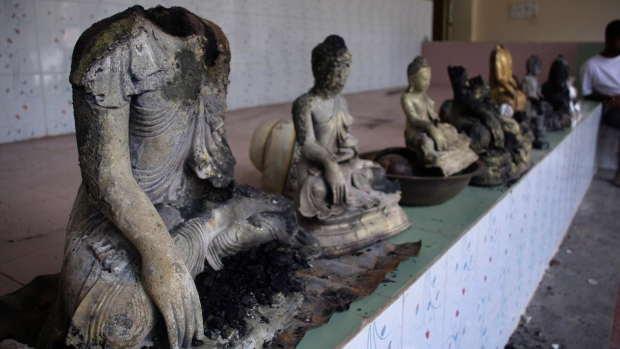 Damaged statues at a Buddhist temple that was torched in Ramu in the coastal district of Cox's Bazar