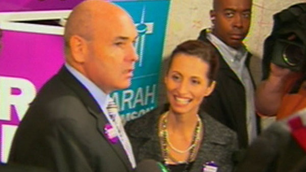 Mayoral candidate George Smitherman and ex-mayoral candidate Sarah Thomson appear before the cameras on Tuesday, Sept. 28, 2010.