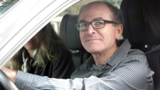 John Norris, one of Omar Khadr's lawyers, is seen as he drives to see his client