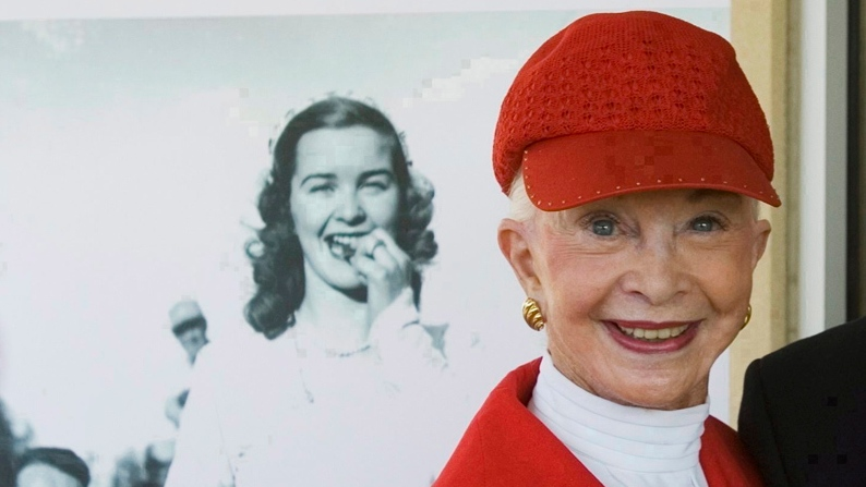 Barbara Ann Scott 1948 Olympic Figure Skating Champion stands in front of a photograph of herself taken during her 1948 Olympic gold medal celebration at a ribbon cutting ceremony for a building named after her in Ottawa, Wednesday May 23, 2007. (Fred Chartrand / THE CANADIAN PRESS)