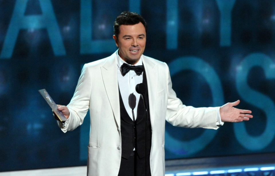 Seth MacFarlane presents an award onstage at the 64th Primetime Emmy Awards at the Nokia Theatre on Sunday, Sept. 23, 2012, in Los Angeles. (John Shearer / Invision)