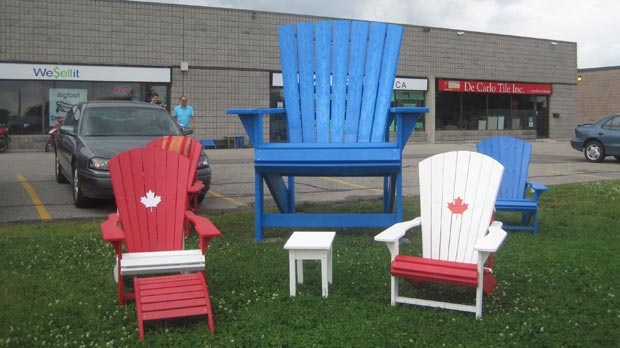 A very large blue Muskoka chair was stolen from this display outside WeSellit Ltd. in Waterloo, Ont.