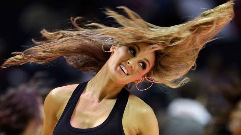 Charlotte Bobcats dancer and American Idol contestant Brittany Kerr performs during the first half of an NBA basketball game between the Charlotte Bobcats and the Washington Wizards in Charlotte, N.C., Saturday, Jan. 28, 2012. (AP Photo/Chuck Burton)