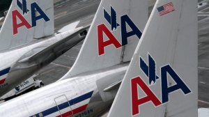 American Airlines airplanes are seen parked at a gate at JFK International airport in New York, Aug. 1, 2012. (AP / Mary Altaffer)