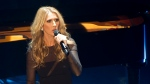 Celine Dion opens a benefit concert for the victims of the election night shooting on Monday night. (Paul Chiasson / THE CANADIAN PRESS)