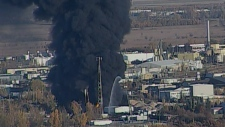 Fire crews are battling a massive blaze at a warehouse in Winnipeg on Monday, Oct. 1, 2012.