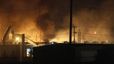 Fire fighters battle a blaze at Speedway International, a methanol fuel plant in Winnipeg on Monday,