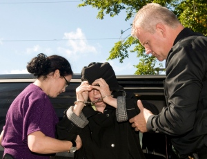 Melissa Ann Weeks, of New Glasgow, N.S., also known as the 'Internet Black Widow,' leaves a Cape Breton Regional Police Services vehicle for a court appearance at the Sydney Justice Centre, Tuesday, Oct.2, 2012. (Vaughan Merchant / THE CANADIAN PRESS)