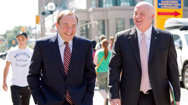NHL commissioner Gary Bettman, left, and Bill Daly, deputy commissioner and chief legal officer of the NHL, leave the NHLPA offices in Toronto on Wednesday, Aug. 22, 2012. (Chris Young / THE CANADIAN PRESS)