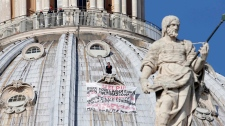 Marcello di Finizio protests on St. Peter's dome at the Vatican on Oct. 3, 2012.
